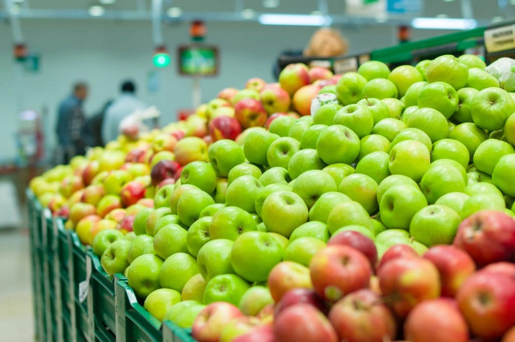 organic produce in the grocery store apples